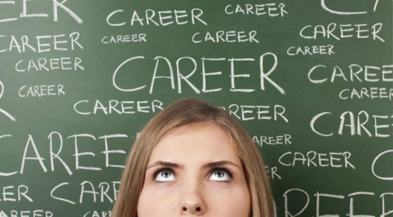 Woman looking up before a chalkboard - Career
