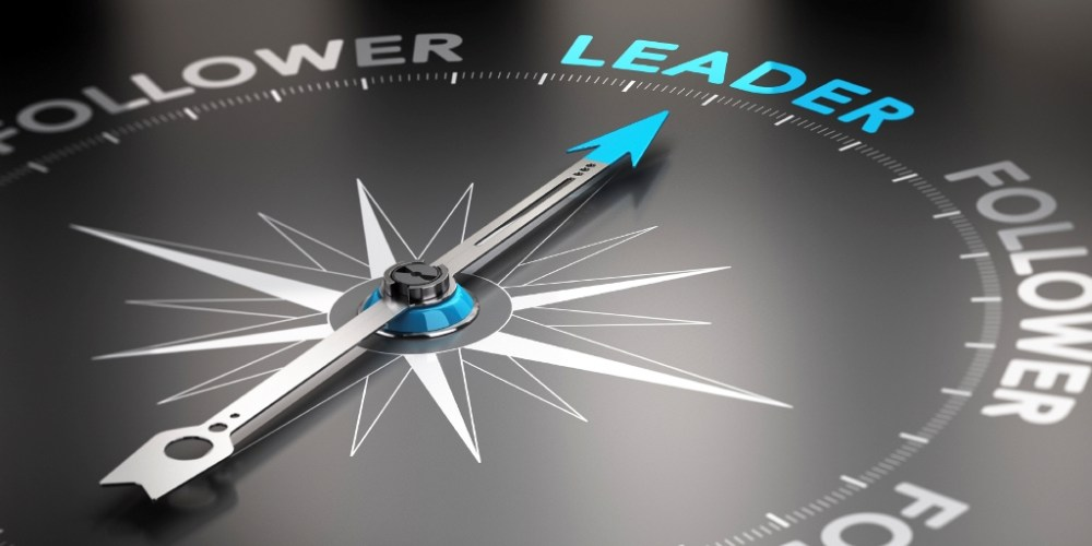 Compass pointing to Leader - Follower - Leadership Management